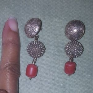 Sterling silver earring with marking